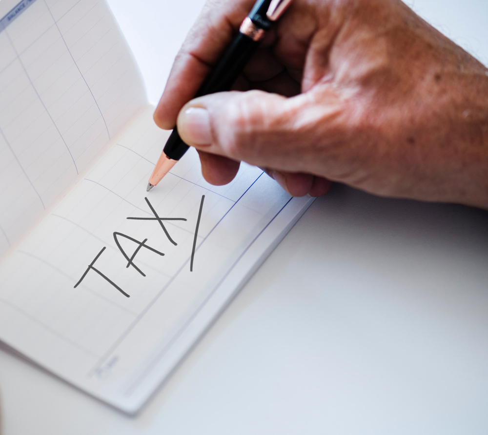 image showing the word tax